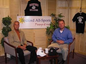 Paul Woodmansee and Bill Whitmore talk in a TV studio setting for Bedford All Sports